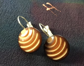 Vintage hand carved wood button earrings with blond and brown Art Deco symetrical design.
