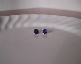Tiny sapphire stud earrings set in sterling silver; sapphire post earrings; small sapphire earrings silver; september birthstone