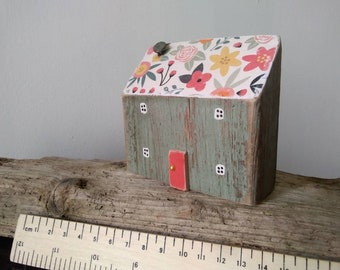 Freestanding cottage/house made from driftwood and other reclaimed materials and beach finds