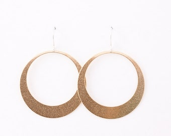"""Modern hoop earrings, sleek design and large size of these gorgeous earrings will make a statement anywhere - """"Lunar Hoops in Brass - Large"""""""