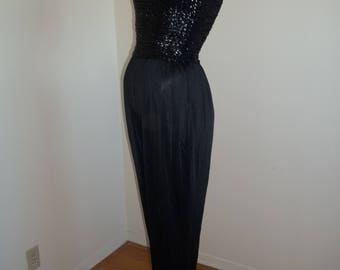 Be ready to boogie in this radical sequin jumpsuit. Vintage 80s but new with tags. Size 10