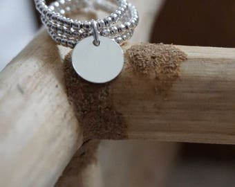 Trio of 925 sterling silver beads and a medal ring