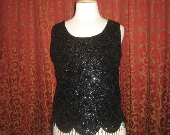"1960's, 38"" bust, beaded and sequined black wool shell,"