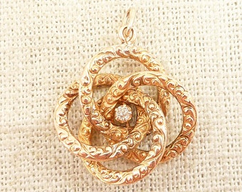 Antique Textured 14K Gold Infinity Knot Pendant with Diamond Accent