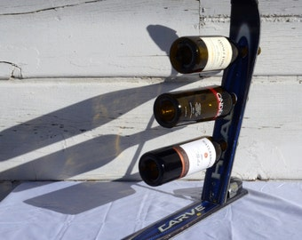 vinSki, a 3-bottle upcycled ski wine rack, is a great accent to your mountain chalet, ski cabin, condo, tasting room, or cellar by upCyD
