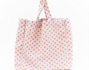 XL Multipurpose bag in orange star fabric. Inside pocket with zipper