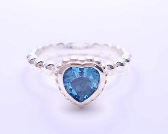 Silver ring bezel set Topaz heart