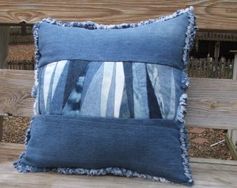 Denim patchwork pillow sham with form. The front is sewn using triangle shaped scraps cut from recycled denim from multiple pairs of jeans.