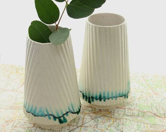 Green and white glazed ceramic vase on floating base. White porcelain vase with ceramic texture cast from take away cups. Housewarming gift.