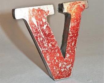A fantastic vintage style metal 3D red letter V