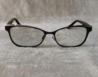 JIMMY CHOO Womens eyewear. Model 147 Gold trim and Leopard animal print frames