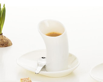 Porcelain espresso set. Pause and enjoy!  Take your time and enjoy a good espresso from the curved cups.