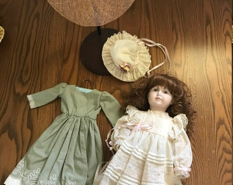 Dorothy - a handmade porcelain doll with stand, dresses, hats