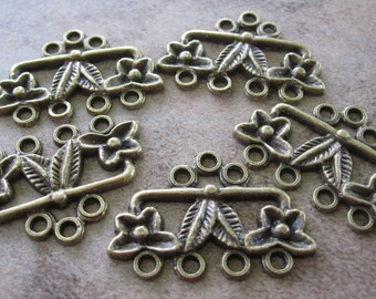 20  Antiqued Brass Pewter Drops, 26x9mm Flower with Leaf, 7 loops total - JD25