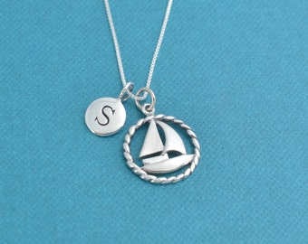 Sailboat necklace in sterling silver personalized with sterling silver 5 mm letter charm on a sterling silver box chain