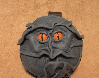 Grichels leather earbud case/wallet - teal green with poppy orange slit pupil reptile eyes