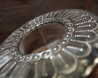 tin circle round mirror small hand punched New Mexican tinwork Jason Younis y Delgado www.newmexicotinwork.com