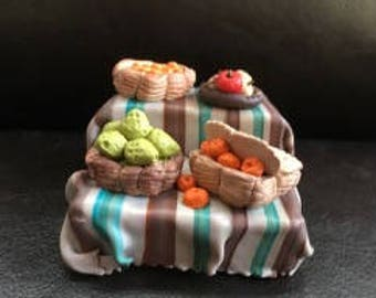 Nativity scene with polymer clay: first, stall of fruits and vegetables