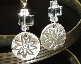 Flowery disks - silver clay with gray rectangles and crystal cubes