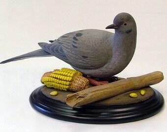 "Wood sculpture of Mourning Dove entitled, ""Autumn Harvest."""