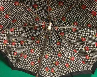 1970's Henryson T.U.F.I. 1970's umbrella. Navy, White with red/ yellow  flowers