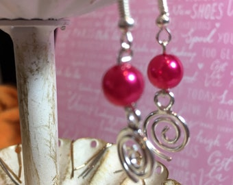 Bright pink pearl earrings with silver filigree dangle.