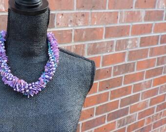 Purple pearls and swril multi-strand necklace