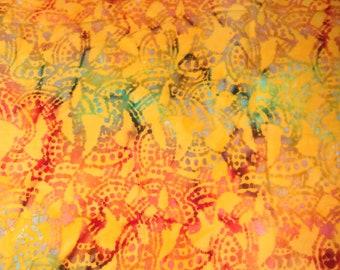 Tissu coton BATIK très coloré jaune d'or et rouge