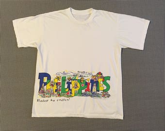 """1990's, super soft """"PHILIPPINES"""" t-shirt, in white with brightly colored graphics, Men's size Large, Women's size XL"""