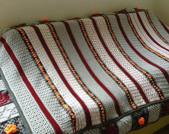 Striped and many coloured throw for a single bed 180x140cm