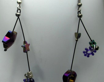 Lacy, purple unmatched, stars, flowers, hearts,  dangle earrings.  sculptural, handmade, contemporary. steampunk