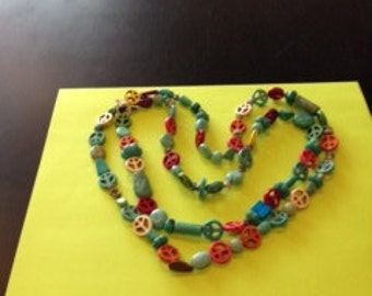 Turquoise  peace necklace.