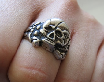 Vintage sterling silver (rock or biker's ) ring shaped as skull and cross bones, vintage skull ring, silver skull ring, cool skull ring.