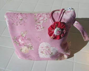 Clutch bag, padded pink beauty case.