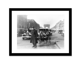 Black and white photo of a Tricyle on the champs-Elysees in 1932