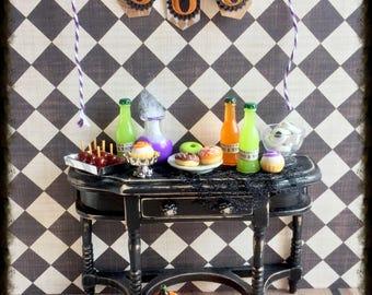 Miniature Halloween sideboard, treats and banner, miniature pumpkin, dollhouse pastries