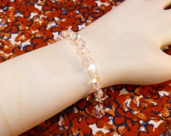 Vintage faceted glass bead bracelet - clear with aurora borealis finish
