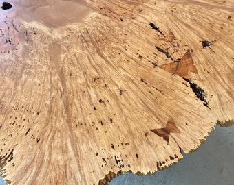 Big leaf maple coffee table with curly koa butterfly keys.