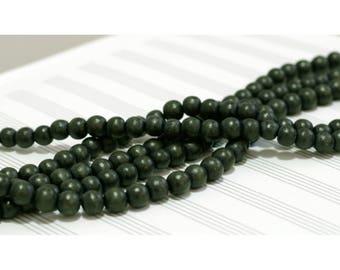 Strand 40 cm round beads 8 mm wood dark gray - green hues