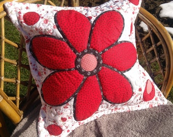 Pillow with red flower