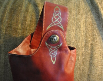 Chaos Genuine Leather Sling bag, Reimagined w/Custom Celtic Bronze Concho and Celtic Knotwork by Wes Connell, Red w/gold & black artwork