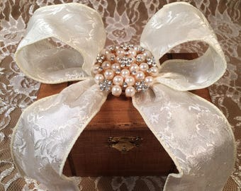 """Wooden Music Jewelry Box Embelished with White Brocade Bow / Rhinestone & Pearl Brooch that can be worn. Plays """"You Are My Sunshine""""."""