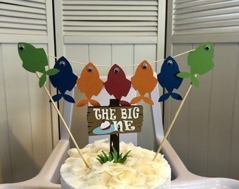 "Fish Cake Topper w/ wiggly eyes & ""The Big One"" sign. FINtastic cake decor for a camping or fishing party!  Contact me for any color combo!"