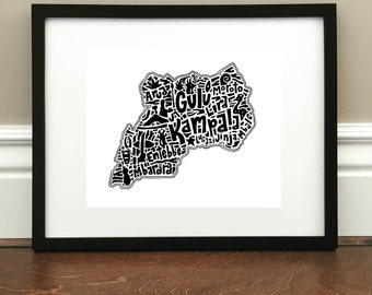 "Uganda Map Art Print - Signed 8.5"" x 11"" print of original hand drawn map including landmarks, culture, symbols, and cities"