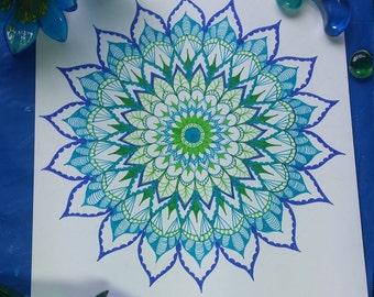 Flower mandala in blue green