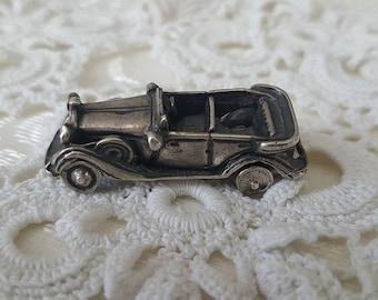 A vintage silver car, presumably 1950s, Germany