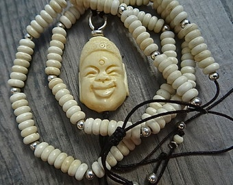 Smiling Buddha necklace.Bone and sterling silver.