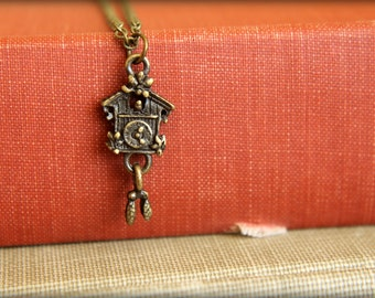 Cuckoo Clock Necklace in Aged Brass