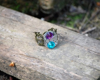 Steampunk Statement Ring with Vintage Watch Movement and a Aqua-Purple Chrytals