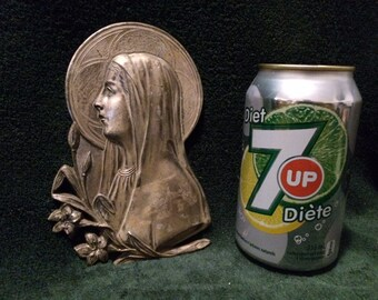 Sculpture bas relief in tin of saint marie
